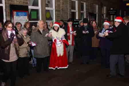 Carol singing on Hebden Bridge Station in 2012